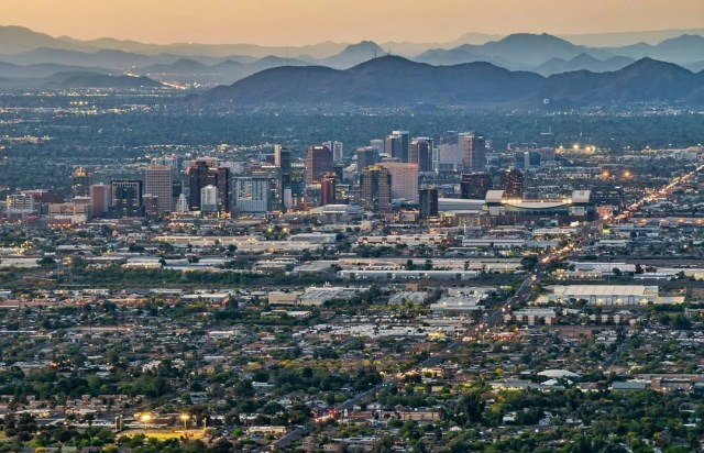 Aerial view of Phoenix from the mountains at sunset. Photo by Instagram user @abhiv_7575