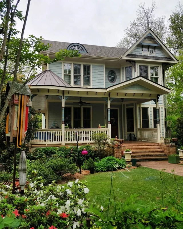 Blue Victorian home with green yard in Lake Claire in Atlanta. Photo by Instagram user @edwardahightower