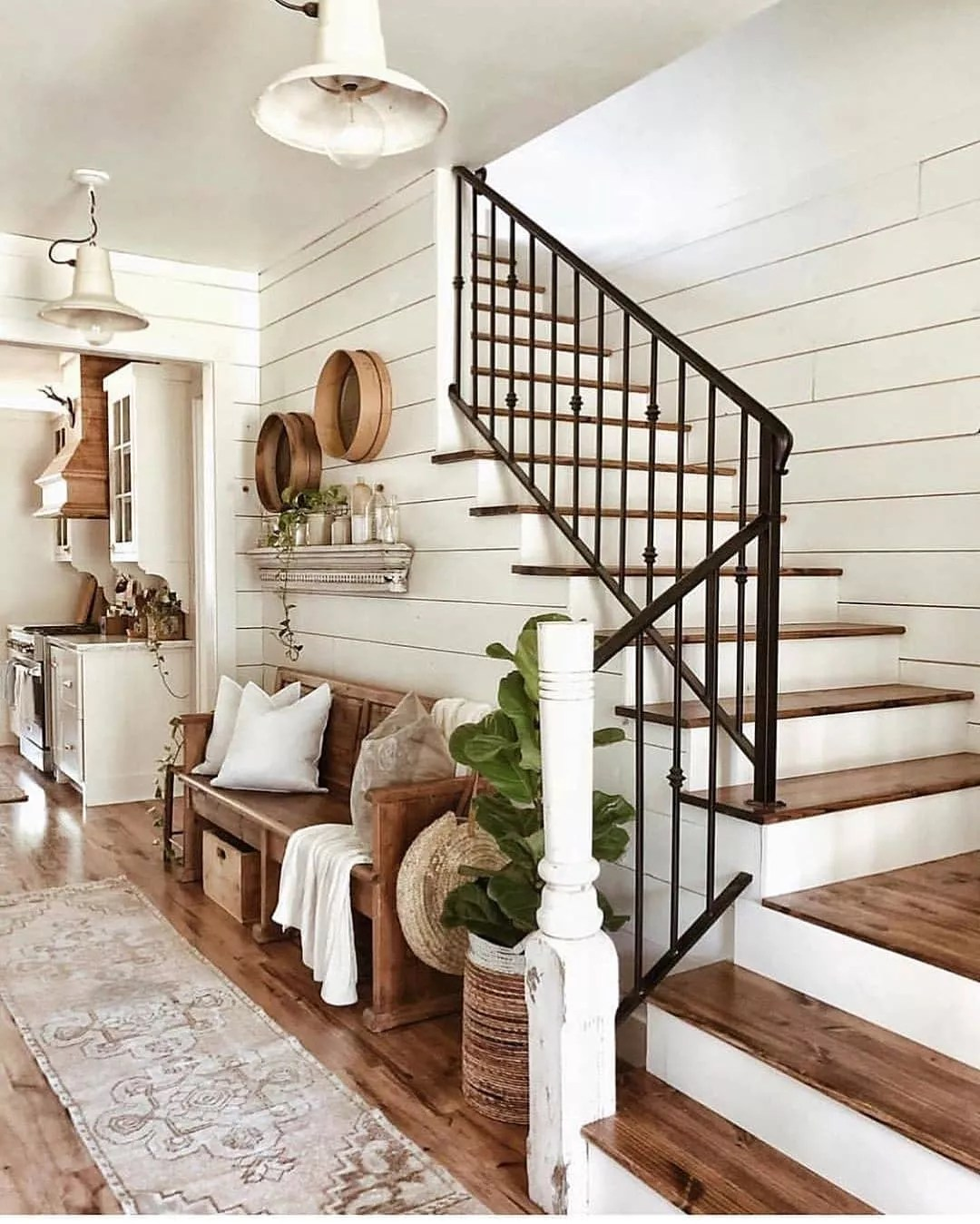 Entryway decorated in Modern Farmhouse with all white walls. Photo by Instagram user @whitetailfarmhouse