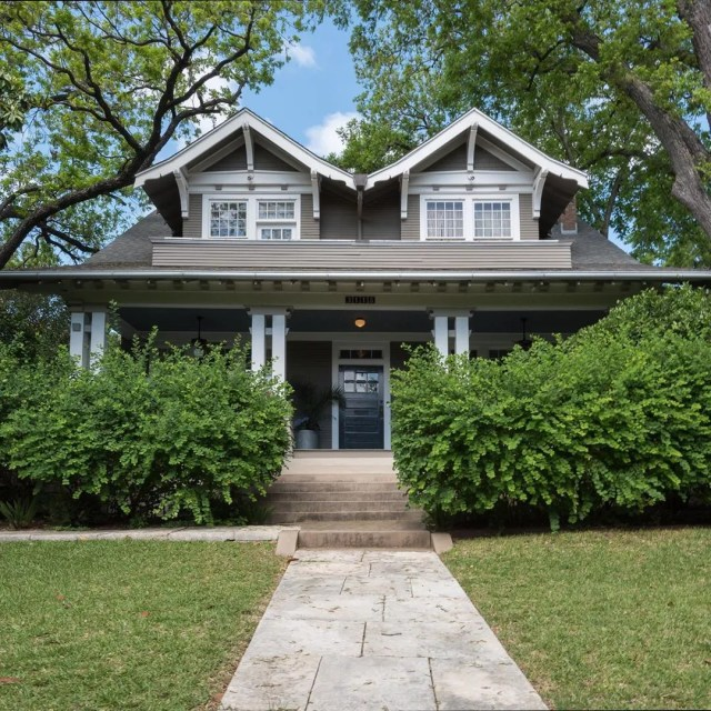 Two-story dark gray house with white trim in North University, Austin. Photo by Instagram user @edgeofthelight
