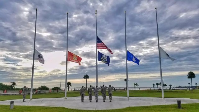 Air force members saluting flags at MacDill AFB. Photo by Instagram user @macdillafb