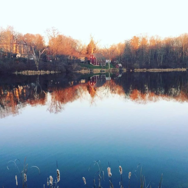 View of pond with house in Spencer, MA. Photo by Instagram user @spencer_spark