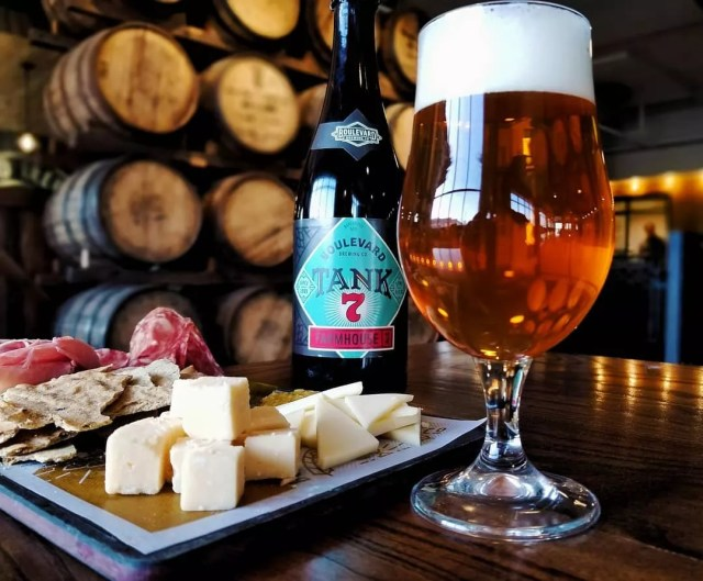 Bottle of beer next to a meat and cheese board. Photo by Instagram user @boulevard_beer