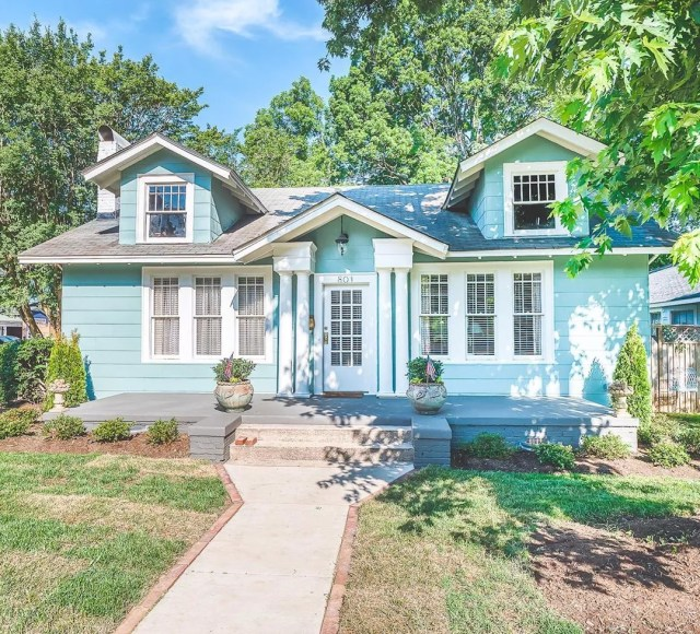 Baby blue house with white trim and white door in Elizabeth, Charlotte. Photo by Instagram user @gwrealestate