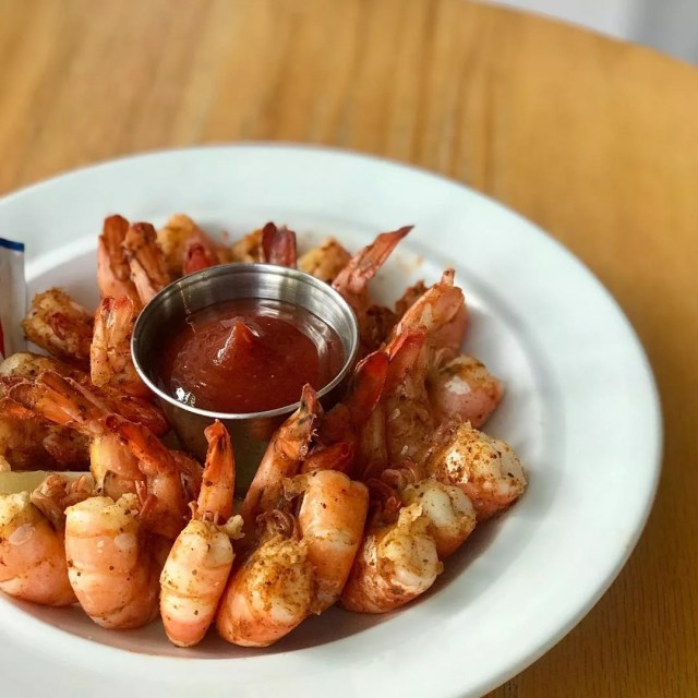 Shrimp in a bowl with sauce. Photo by Instagram user @hanksoysterbar