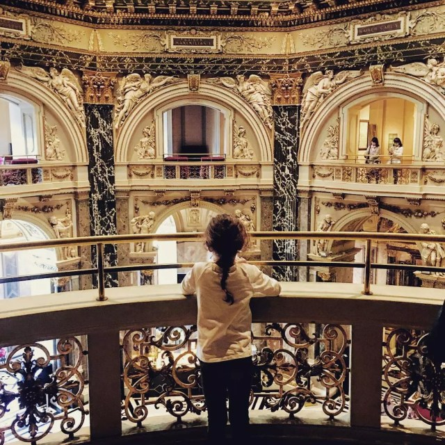 Little girl standing inside Vienna museum. Photo by Instagram user @theexpatchronicle