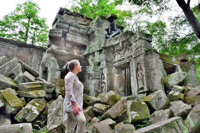 Girl standing in front of temple rubble. Photo by Instagram user @mappingmegan