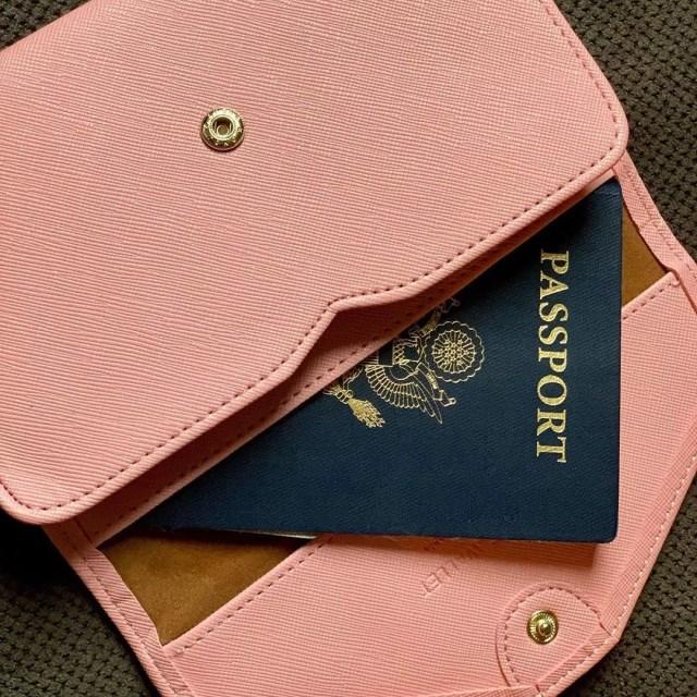Passport in a pink wallet. Photo by Instagram user @prettylittlepassports