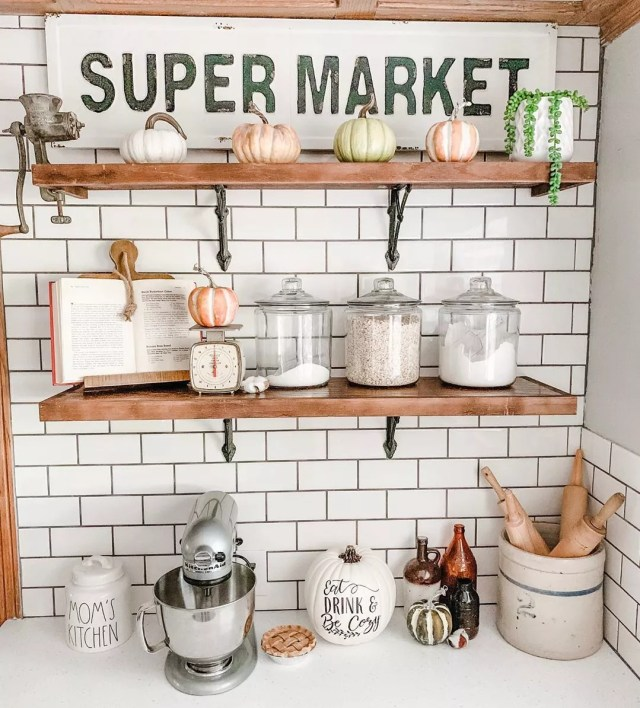 Kitchen shelves with antique items. Photo by Instagram user @redbrickfauxfarmhouse