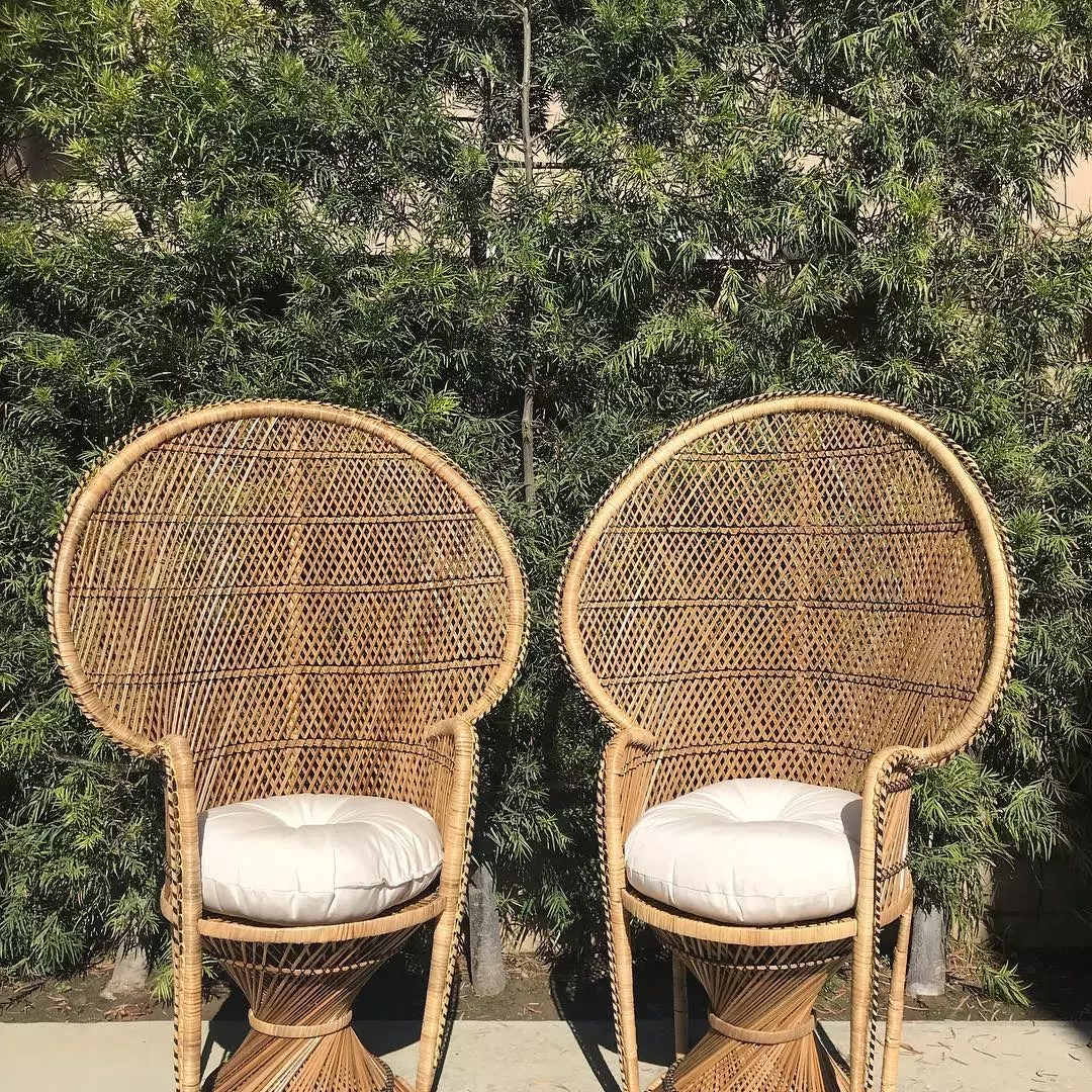 Two brown wicker peacock chairs. Photo by Instagram user @dejavidecors