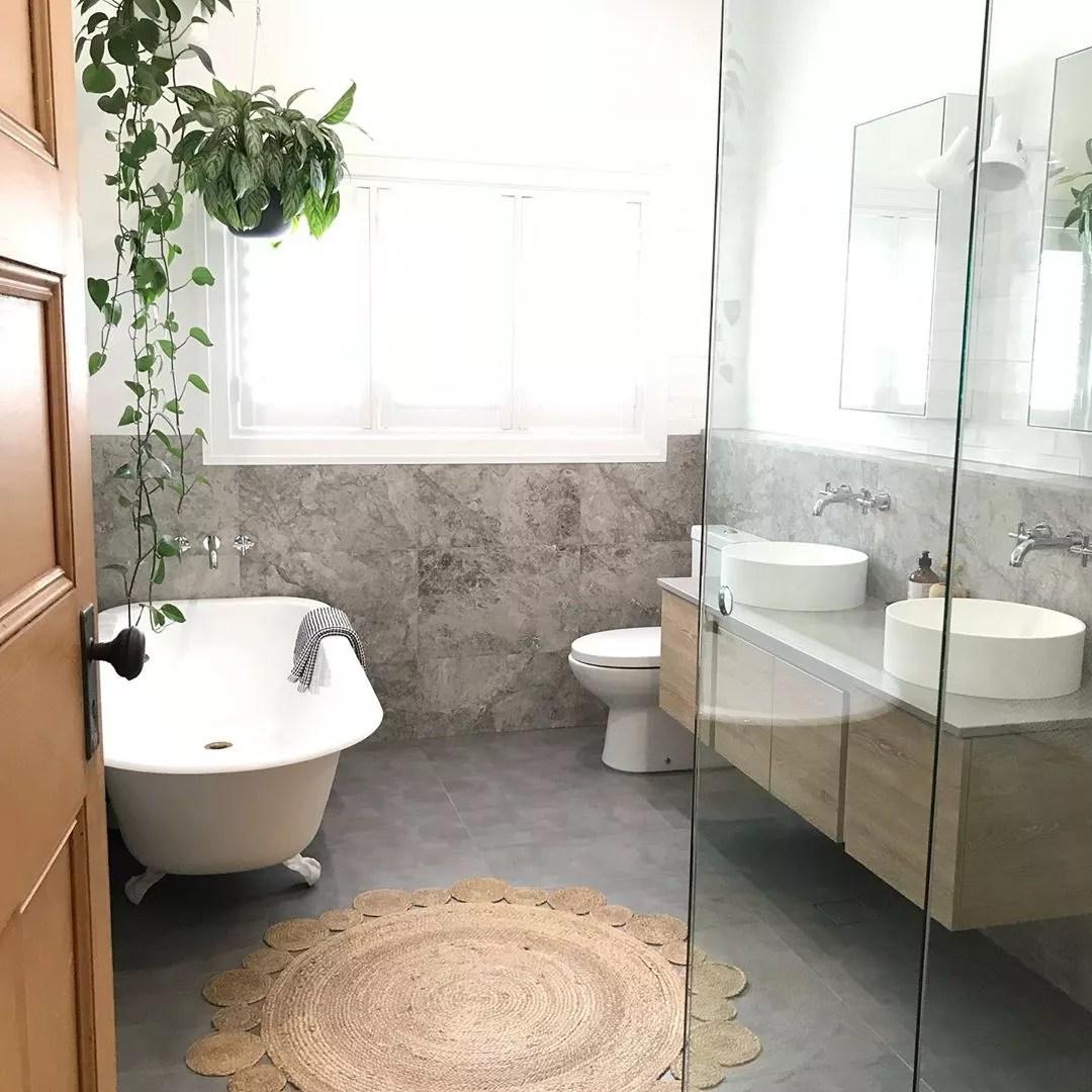 Modern bathroom with vintage rug. Photo by Instagram user @inside_78