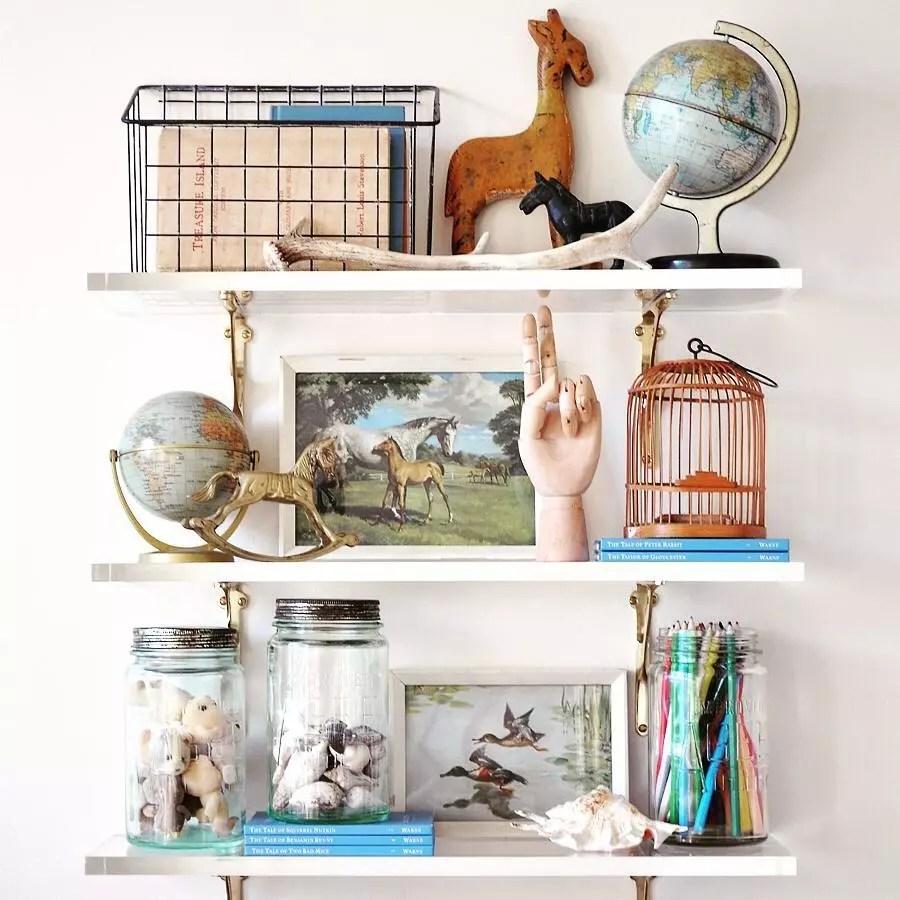 Vintage knick-knacks on shelves. Photo by Instagram user @thepaintedhive