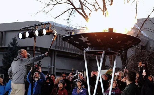 Guy lighting the Olympic torch. Photo by Instagram user @olympiccityusa