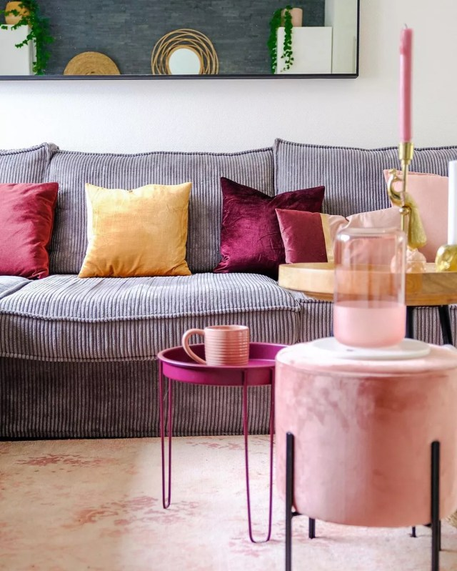 Pink and gold vintage items in living room. Photo by Instagram user @xcuseme.nl