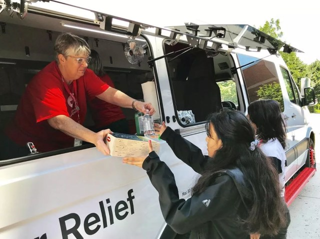 Girl at American Red Cross truck. Photo by Instagram user @americanredcross