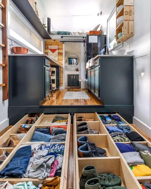 Tiny kitchen with storage in the floor. Photo by Instagram user @livingbiginatinyhouse