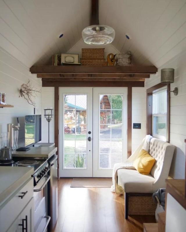 White french doors showing outside. Photo by Instagram user @tinyheirloom