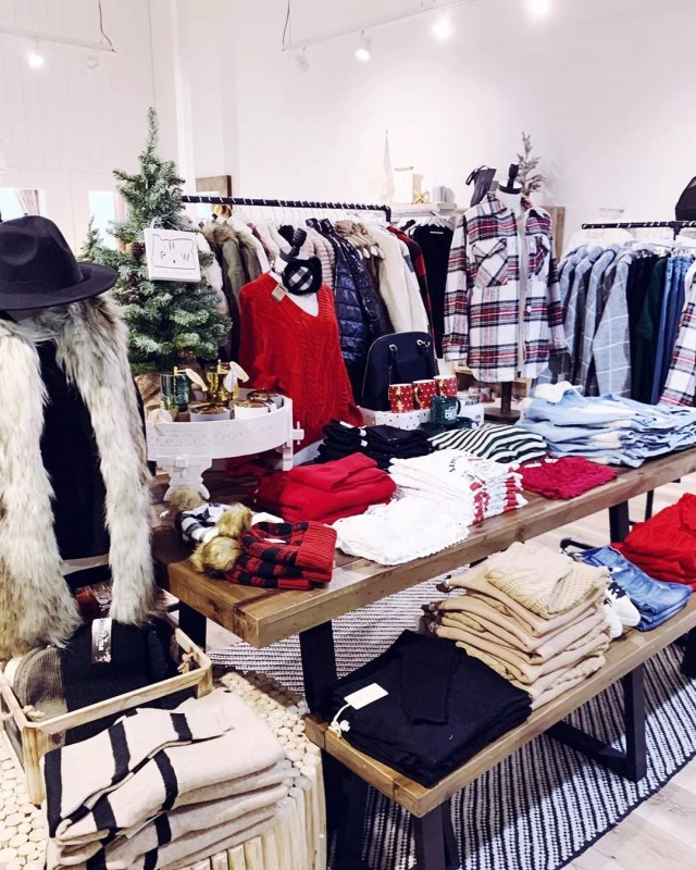 Clothes on hangers and table in store. Photo by Instagram user @cupcakedoesitagain