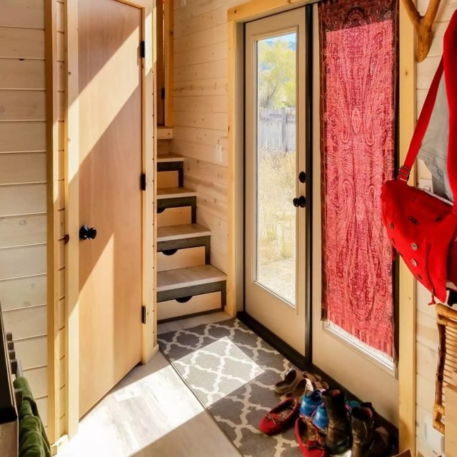 Tiny home entryway with storage stairs. Photo by Instagram user @heatherdhansen