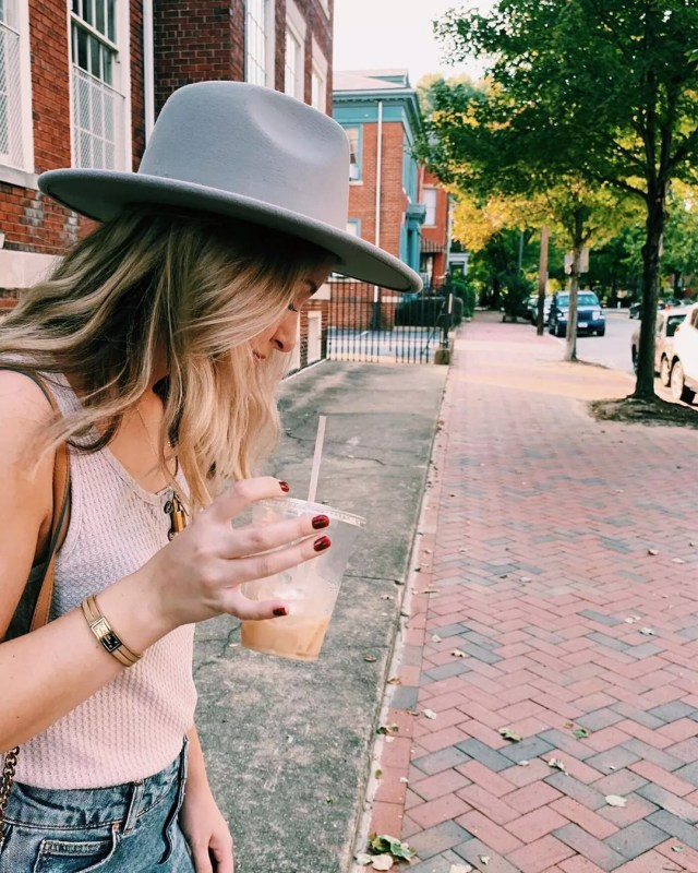 Woman with iced drink from Lamplighter Coffee Roasters in Richmond, VA. Photo by Instagram user @heidisthriftyfinds