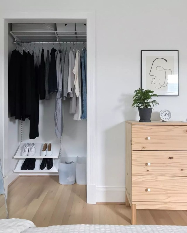 White bedroom with tan dresser and minimalist closet. Photo by Instagram user @minima_organizing