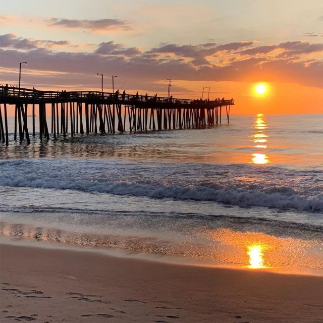 People fishing off of pier at sunset. Photo by Instagram user @nikisch45
