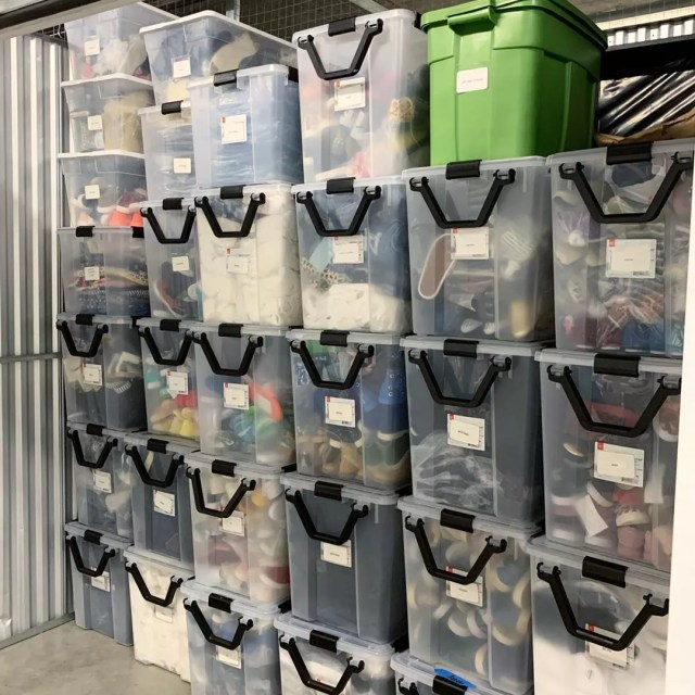 Clear storage bins in a storage unit. Photo by Instagram user @open4organizing