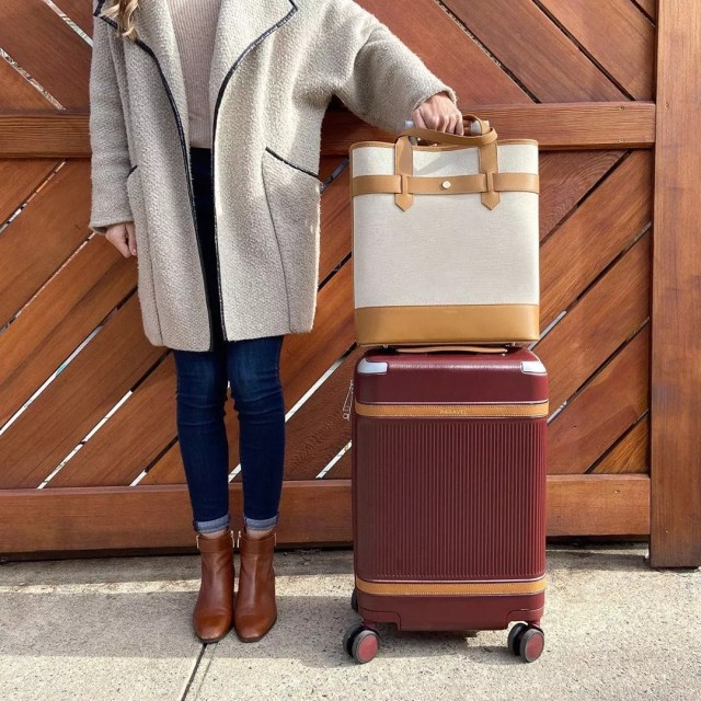 Girl standing next to packed suitcases. Photo by Instagram user @paravel