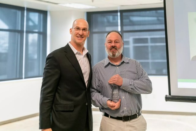 Steven Evans, District Team Lead, poses with Joe Margolis, CEO of Extra Space Storage