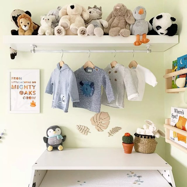 baby room with floating shelf with stuffed animals on top and clothes hanging photo by Instagram user @littleterracedhouse