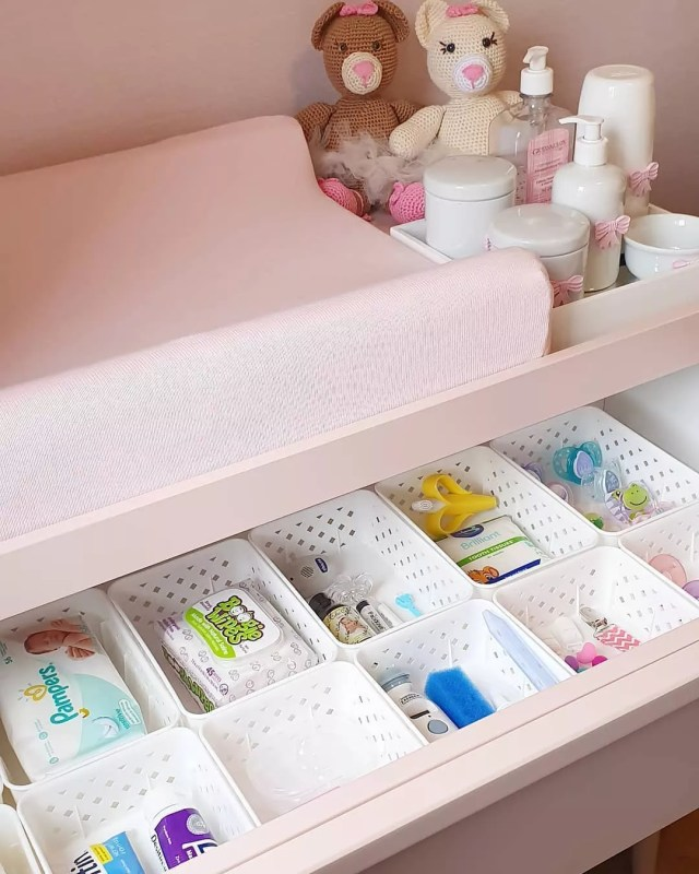 pink dresser with white plastic baskets holding small items photo by Instagram user @equilibriumservices
