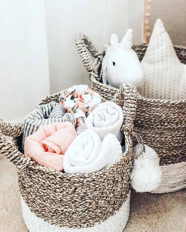 woven baskets with baby blankets and stuff animals inside photo by Instagram user @mylittlehomeideas