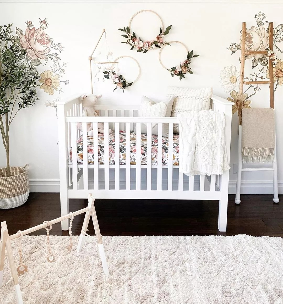 Floral themed nursery. Photo by Instagram user @house.becomes.home