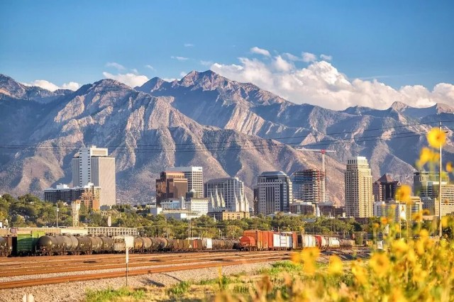 downtown Salt Lake City in view with mountains in the back photo by Instagram user @sherpa_solution