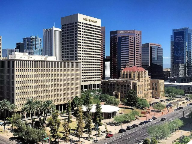 photo of downtown phoenix, az with bright blue sky and trees photo by Instagram user @justinpazera