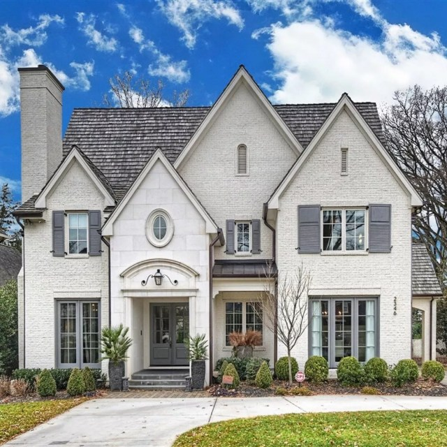large house in myers park charlotte with white brick and gray accents photo by Instagram user @ivesterjacksonchristies
