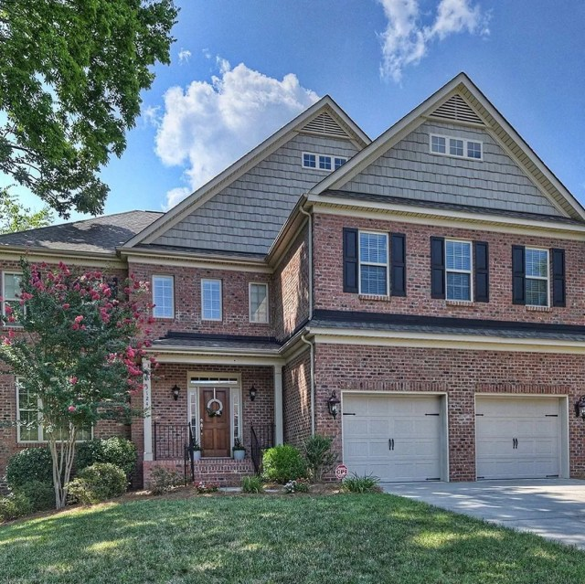 large red brick home in old providence north charlotte photo by Instagram user @mahoolnancerealtors