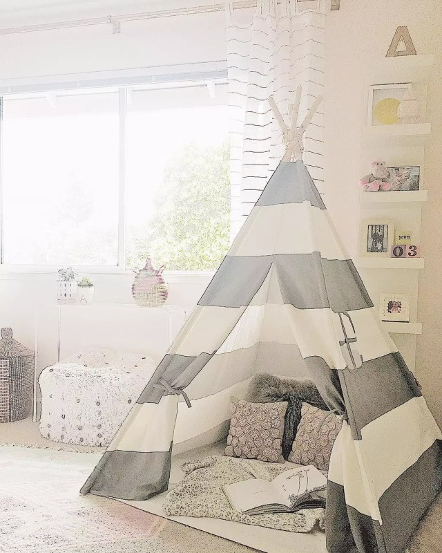 Nursery with gray and white tent. Photo by Instagram user @lindsaysaccullointeriors
