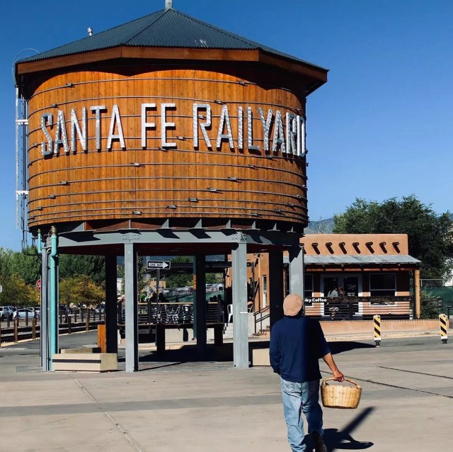 person walking in front of the water tower at the Railyard in santa fe photo by Instagram user @d_p_photo_