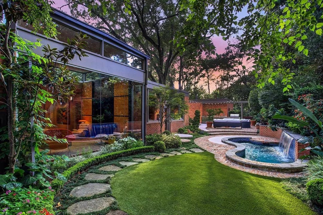 backyard space with a pool and open patio with trees all around photo by Instagram user @gailhartz_associates
