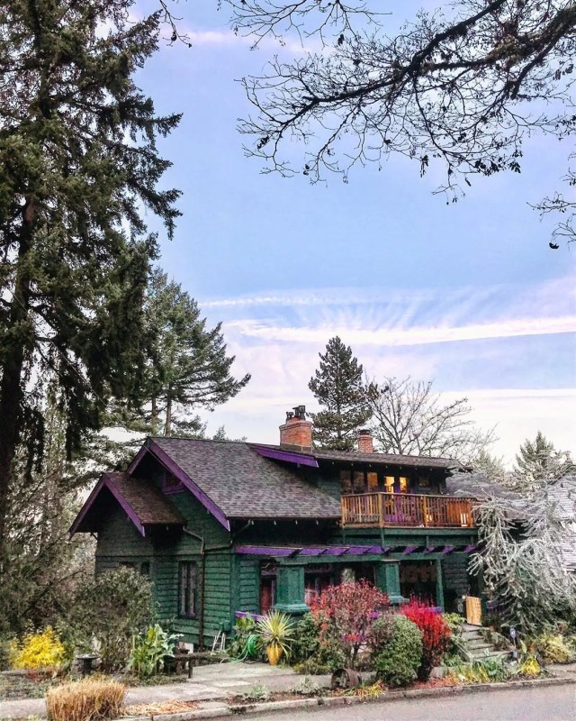 home in forest park, portland, OR with green and purple paint with nice landscaping photo by Instagram user @elvinem11