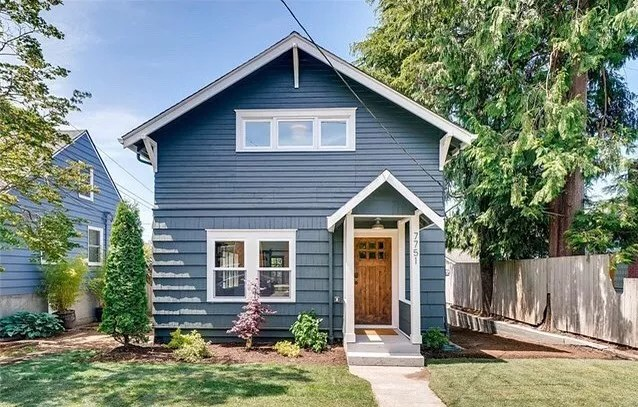 blue craftsman style home with white accents in Ballard, Seattle, WA photo by Instagram user @lakerealestate