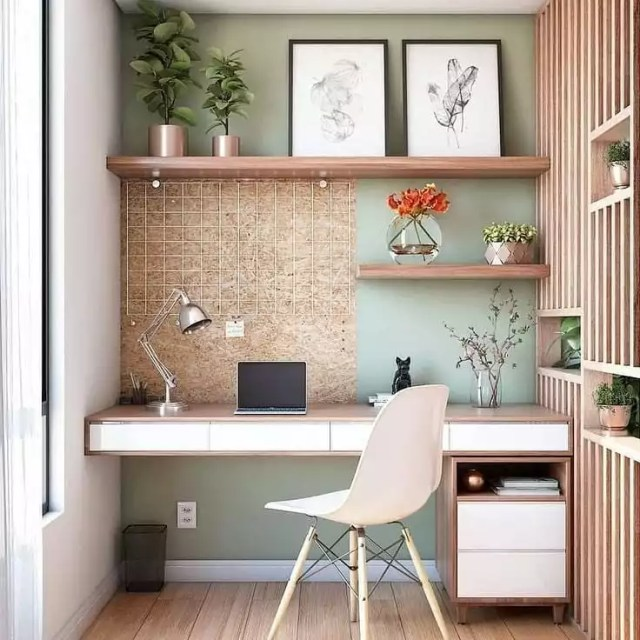 Home office with cork board backing and floating desk photo by Instagram user @raising.architecture