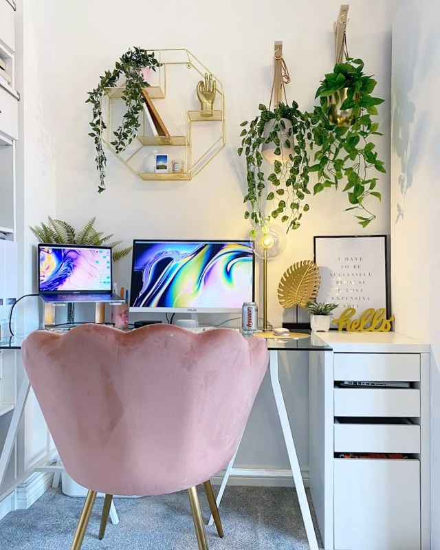 home office with glass desk and odd chair photo by Instagram user @_ohabode