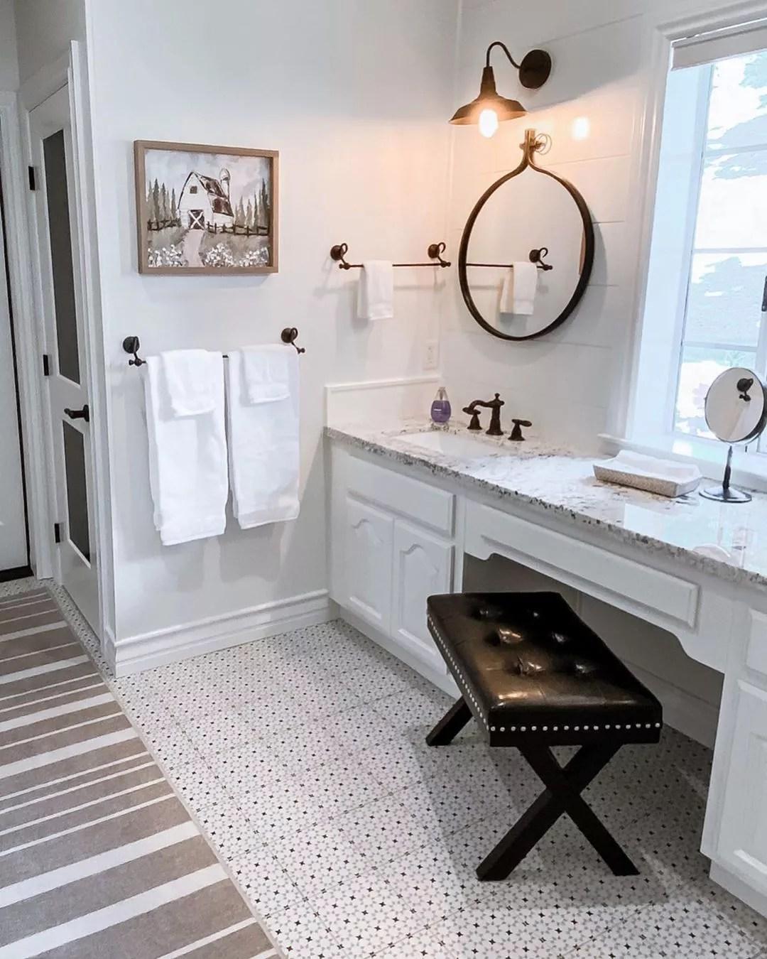 bathroom floor new mosaic tiling under makeup vanity photo by Instagram user @mymodularfarmhouse