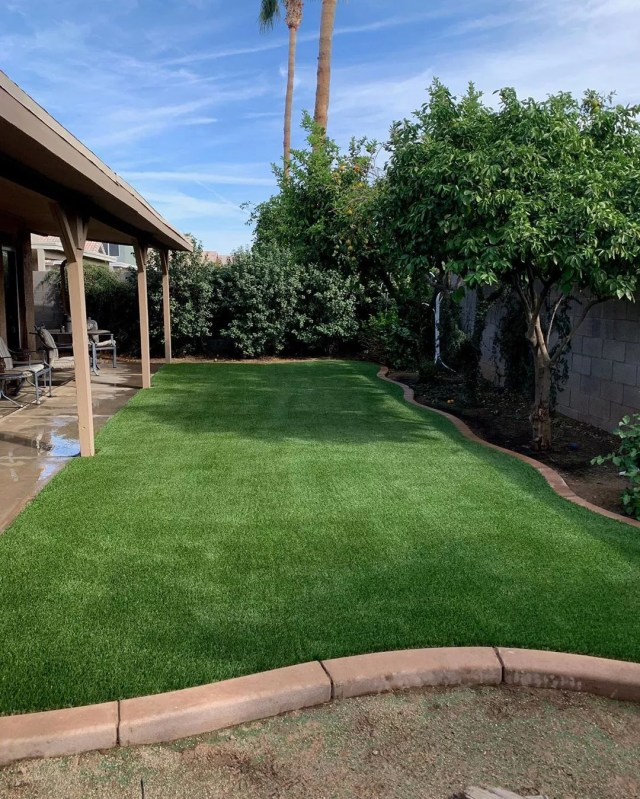 artificial turf installed in small backyard photo by Instagram user @azsyntheticlawns