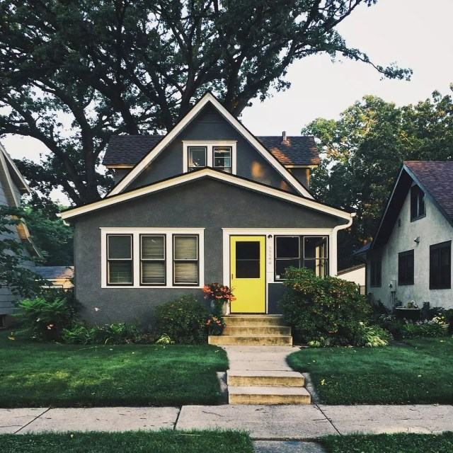 bungalow style home in minneapolis with yellow door photo by Instagram user @studiohahn