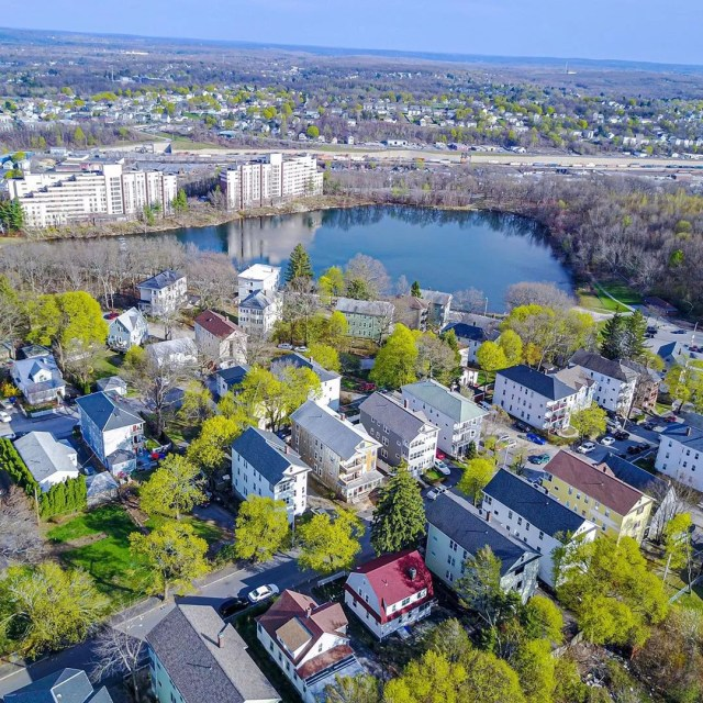 drone shot of homes in worcester, MA photo by Instagram user @sustainablecomfort
