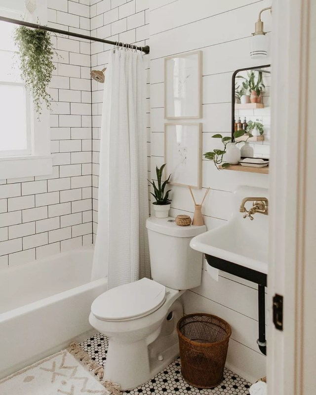 new bathroom with shiplap on the wall and subway tiles in shower and pedestal sink photo by Instagram user @carlanatalia__