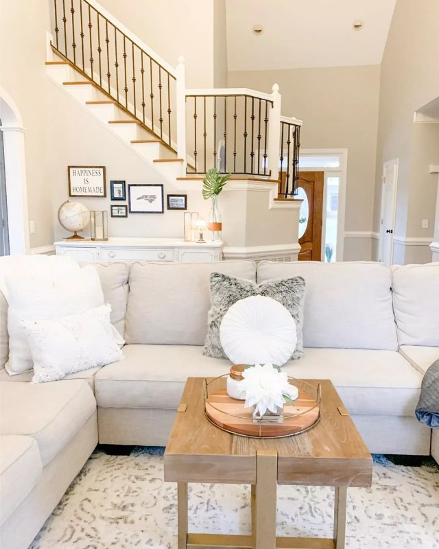 clean living room with little clutter and light color furniture photo by Instagram user @livingwiththelamberts